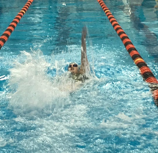 Madison sophomore Adison Floyd competes in the 100 back during Friday's Division II district swim meet at Bowling Green.