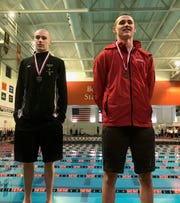 Lexington's Cayman Eichler and Crestview's Ross Kuhn finished second and third, respectively, in the 100 backstroke during Friday's Division II district swim meet at Bowling Green.
