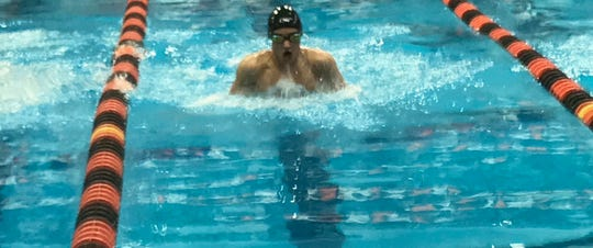 Mansfield Senior sophomore Chase Blackstone competes in the 100 breast during Friday's Division II district swim meet at Bowling Green.