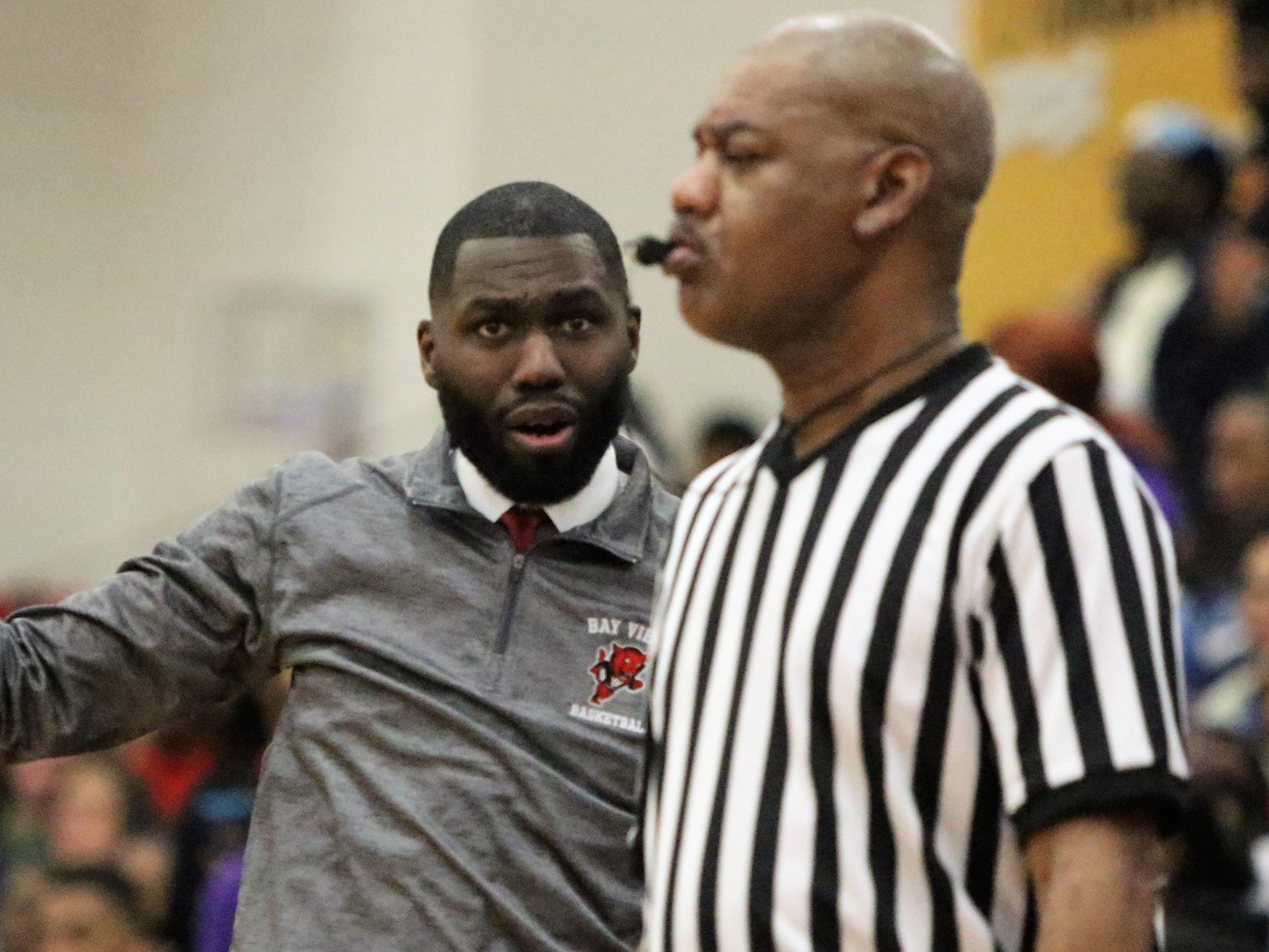 Milwaukee Bay View head coach Darryl Longley asks a referee about a call during his team's game against Milwaukee Washington on Friday night.