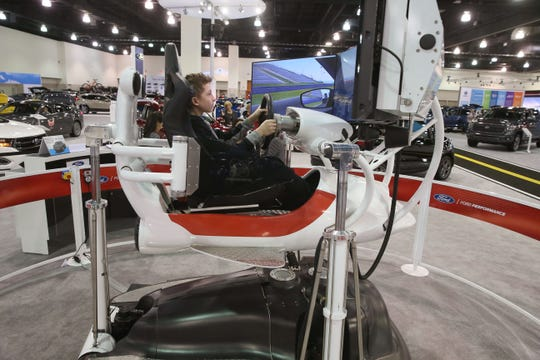A young driver-to-be takes a Ford Focus simulator out for a virtual spin at the 2018 Greater Milwaukee Car & Truck Show. The 2019 edition begins Saturday at the Wisconsin Center.