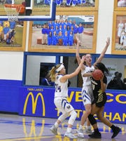 Mountain Home defenders Emma Martin (24) and Anna Grace Foreman double team a Nettleton player on Friday night at The Hangar.