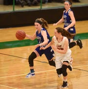 Cotter's Kaylee Crownover makes a steal in the final seconds against Flippin on Friday night.