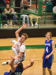 Flippin's Lance May collides with Cotter's Isaac Jones on Friday night in the 2A-1 District Tournament.