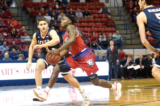 Louisiana Tech junior point guard DaQuan Bracey (4) drives past UTSA's Byron Frohnen (3) during a Conference USA matchup Saturday at the Thomas Assembly Center.