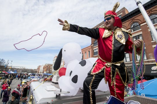 Beads are thrown during the Downtown Business Association Mardi Gras Block Party in Montgomery on Saturday. Beads are thrown during the Downtown Business Association Mardi Gras Block Party in Montgomery, Ala., on Saturday February 3, 2018.