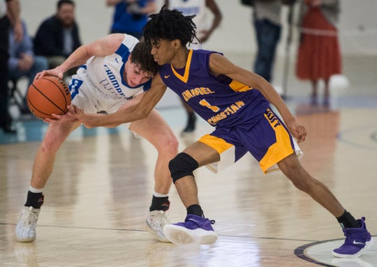 Evangel's Tyree Curry (1) attempts to steal the ball from Chambers' Payton Allen (10) during the AISA Class A boys championship game at Cramton Bowl Multiplex in Montgomery, Ala., on Saturday, Feb. 16, 2019. Evangel defeated Chambers 37-34.