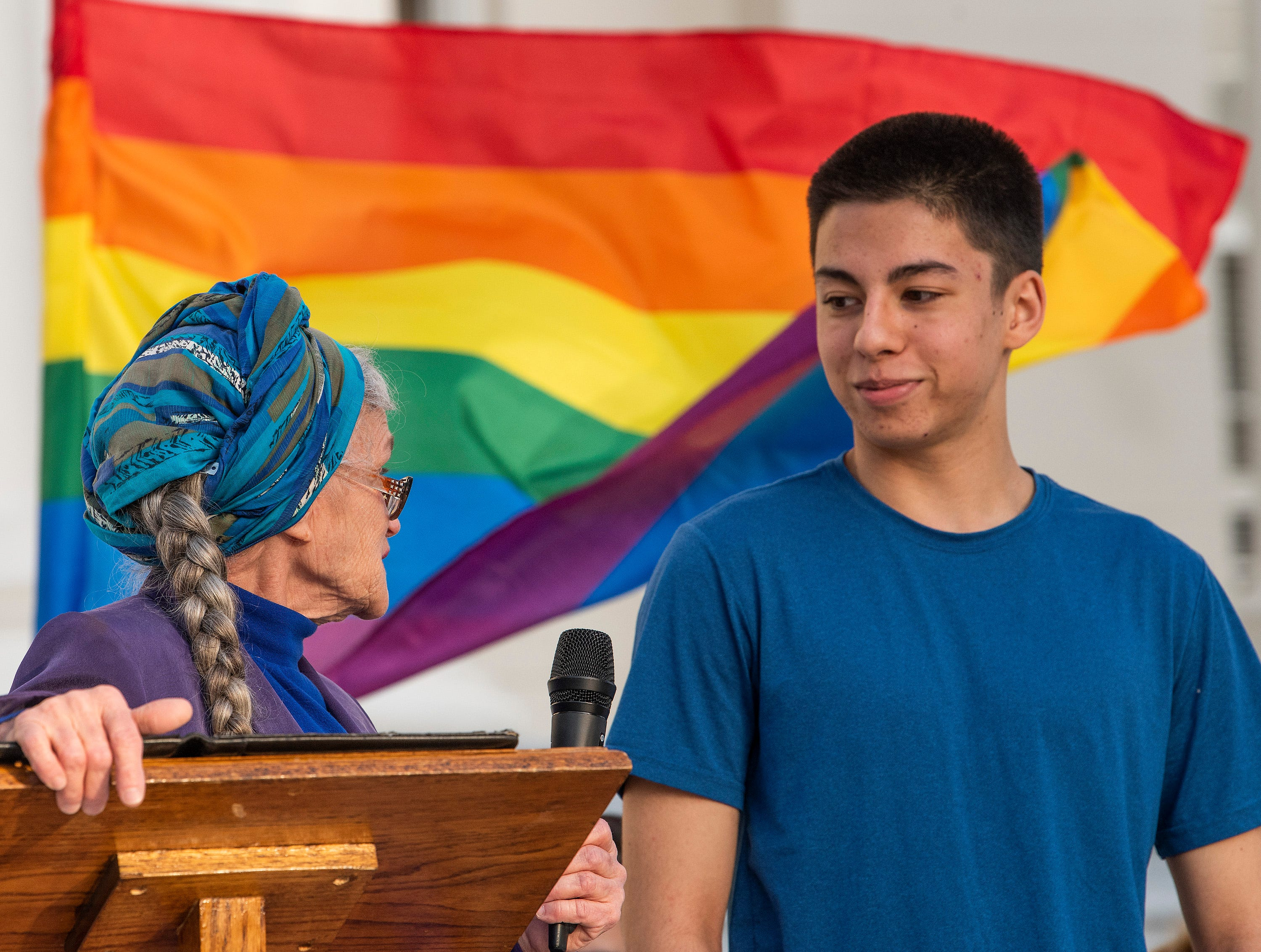 Meta Ellis presents the Stephen Light youth Activist Award  to Eric Samelo, who established the LGBT student group Metamorphosis at LAMP, during the Vigil for Victims of Hate and Violence held on the state capitol steps in Montgomery, Ala., on Saturday February 16, 2019.