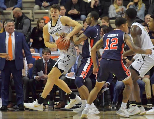 Auburn forward Horace Spencer (0) defends Vanderbilt forward Yanni Wetzell (1) in the first half at Memorial Gymnasium on Feb. 16, 2019, in Nashville, Tennessee.