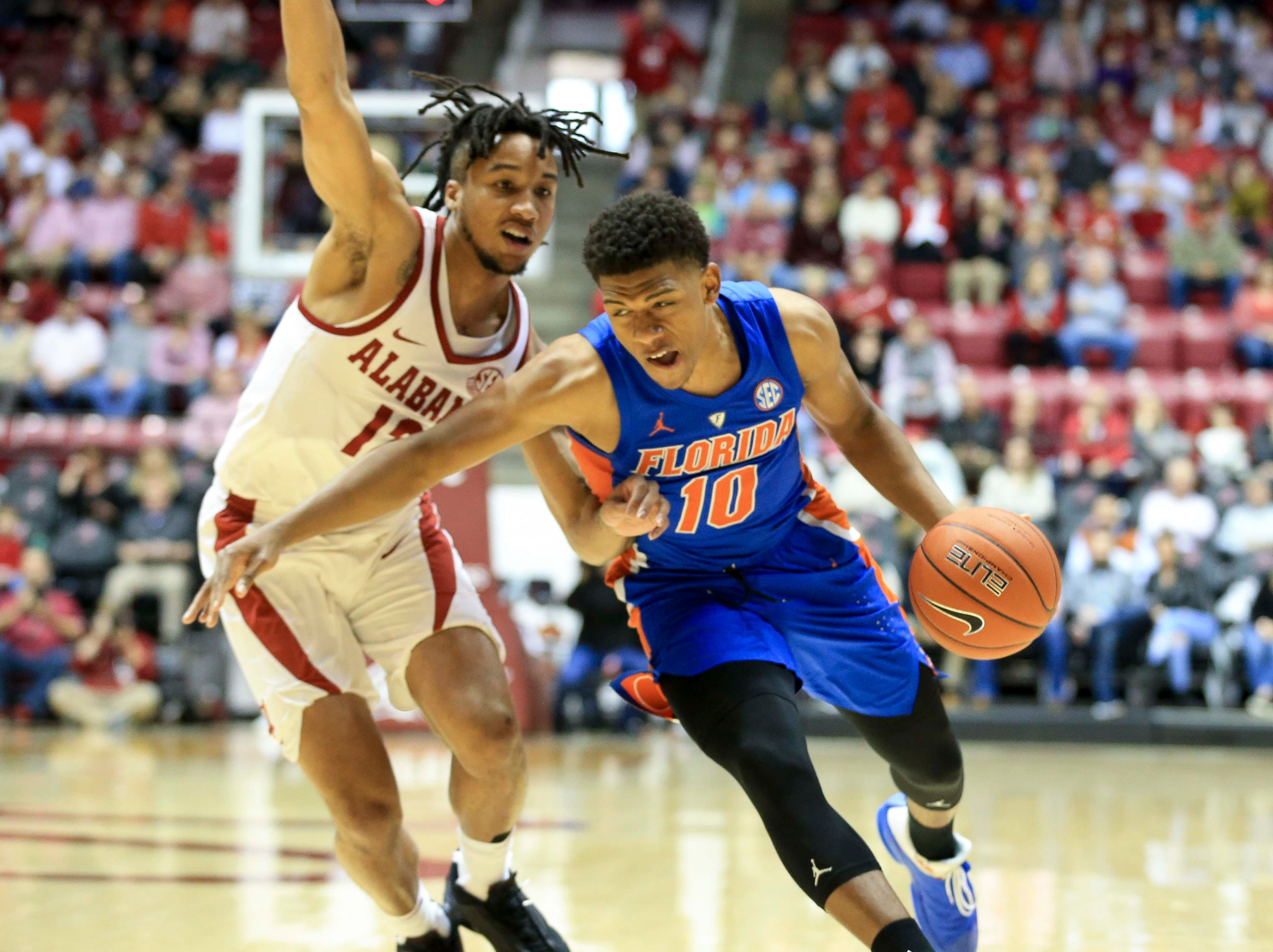 Feb 16, 2019; Tuscaloosa, AL, USA; Florida Gators guard Noah Locke (10) drives to the basket against Alabama Crimson Tide guard Dazon Ingram (12) during the first half at Coleman Coliseum. Mandatory Credit: Marvin Gentry-USA TODAY Sports