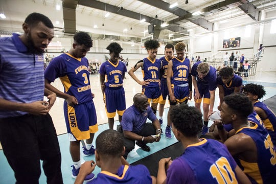 Evangel head coach Kerwin Washington talks with his team during a timeout during the AISA Class A boys championship game at Cramton Bowl Multiplex in Montgomery, Ala., on Saturday, Feb. 16, 2019. Chambers leads Evangel 16-13 at halftime.