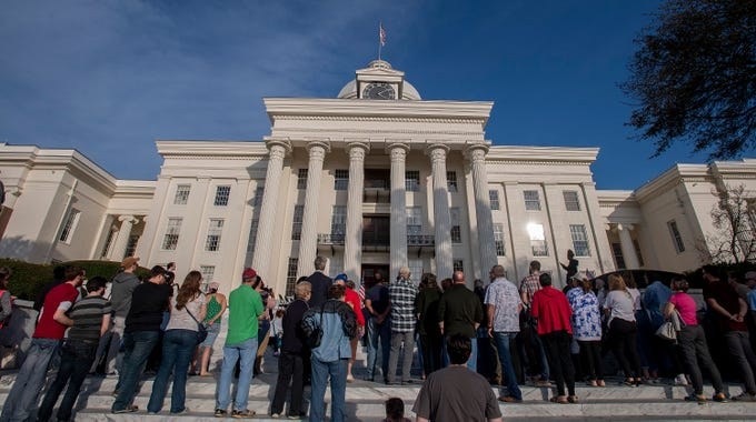 The Vigil for Victims of Hate and Violence is held on the state capitol steps in Montgomery, Ala., on Saturday February 16, 2019.