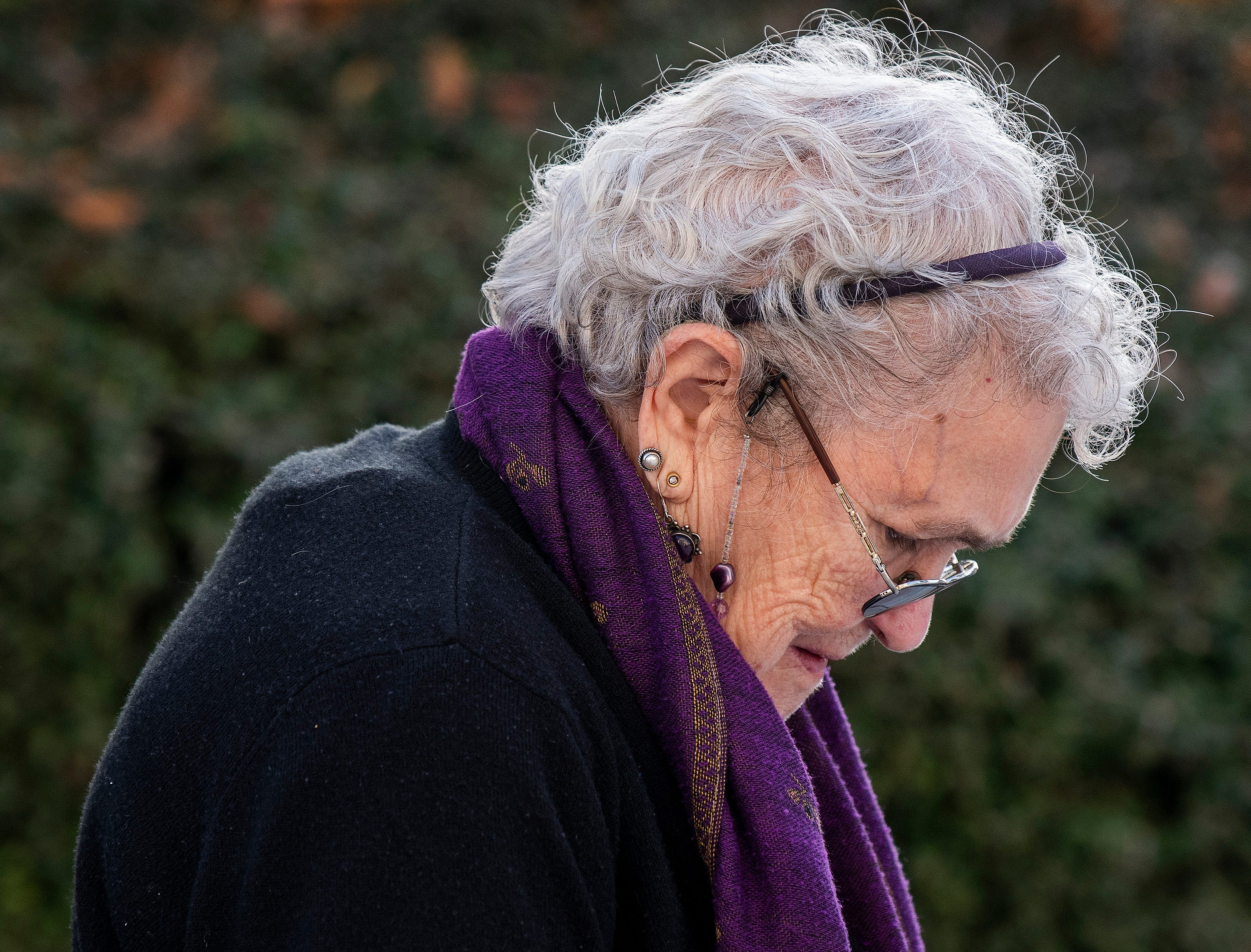 Jeannie Graetz bows her head during a moment of silence during the Vigil for Victims of Hate and Violence held on the state capitol steps in Montgomery, Ala., on Saturday February 16, 2019.