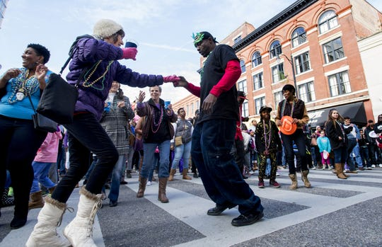 People dance to the live music of the Rebirth Brass Band during the Downtown Business Association Mardi Gras Block Party in Montgomery on Saturday. Dancing to the live music of the Rebirth Brass Band during the Downtown Business Association Mardi Gras Block Party in Montgomery, Ala., on Saturday February 3, 2018.