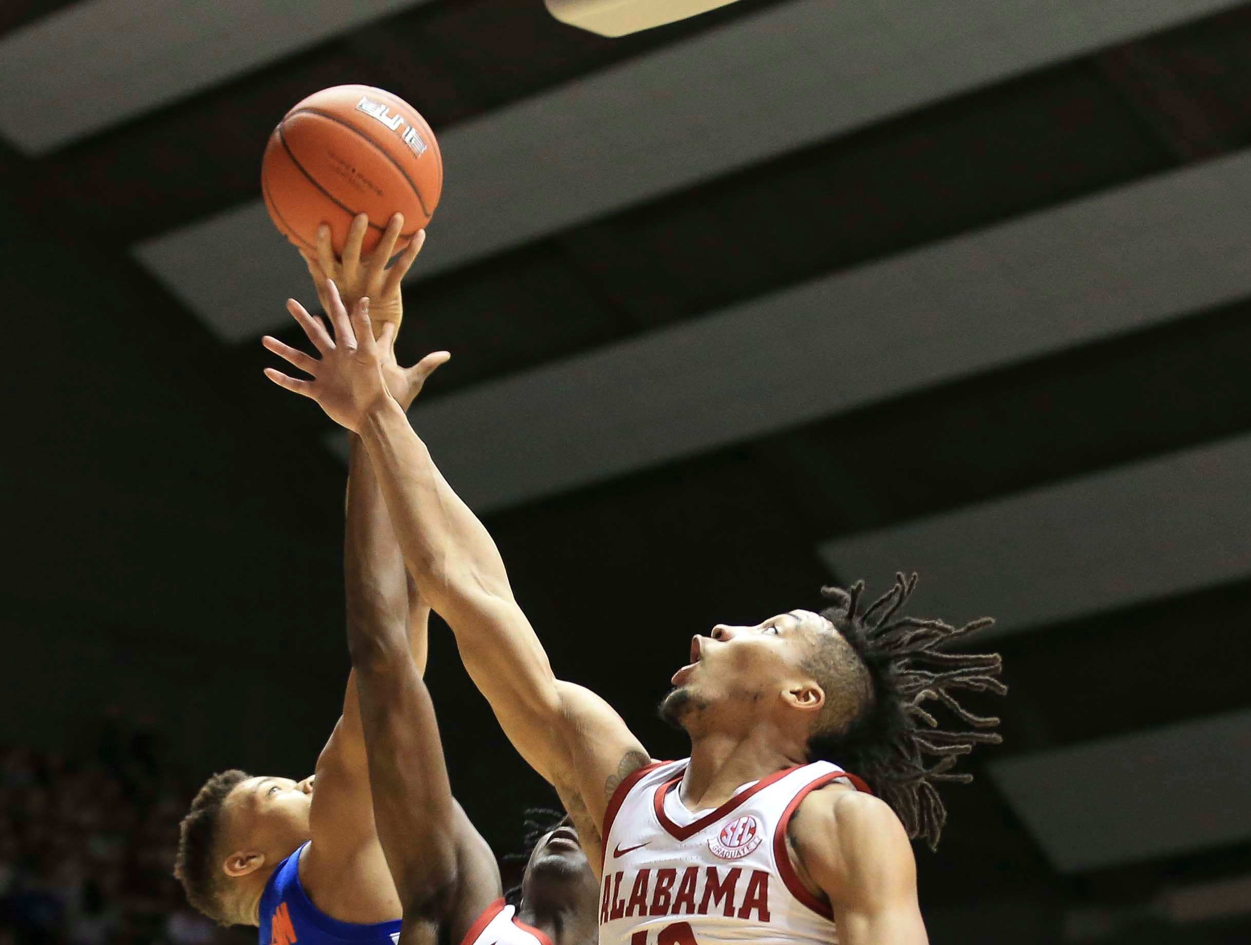 Feb 16, 2019; Tuscaloosa, AL, USA; Alabama Crimson Tide guard Dazon Ingram (12) goes for a rebound against Alabama Crimson Tide guard Kira Lewis Jr. (2) and Florida Gators forward Keyontae Johnson (11) during the first half at Coleman Coliseum. Mandatory Credit: Marvin Gentry-USA TODAY Sports