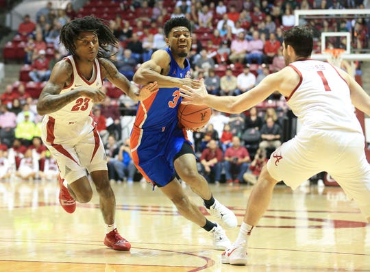 Feb 16, 2019; Tuscaloosa, AL, USA; Florida Gators guard Jalen Hudson (3) drives to the basket against Alabama Crimson Tide guard John Petty (23) during the first half at Coleman Coliseum. Mandatory Credit: Marvin Gentry-USA TODAY Sports
