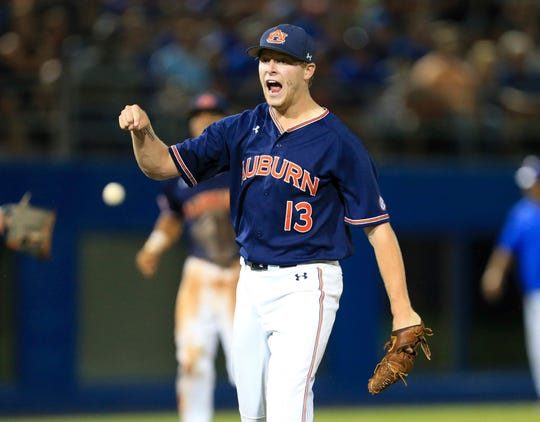 Auburn pitcher Davis Daniel celebrates after getting out of the eighth inning of an NCAA Super Regional against Florida Monday, June 11, 2018, in Gainesville, Fla.