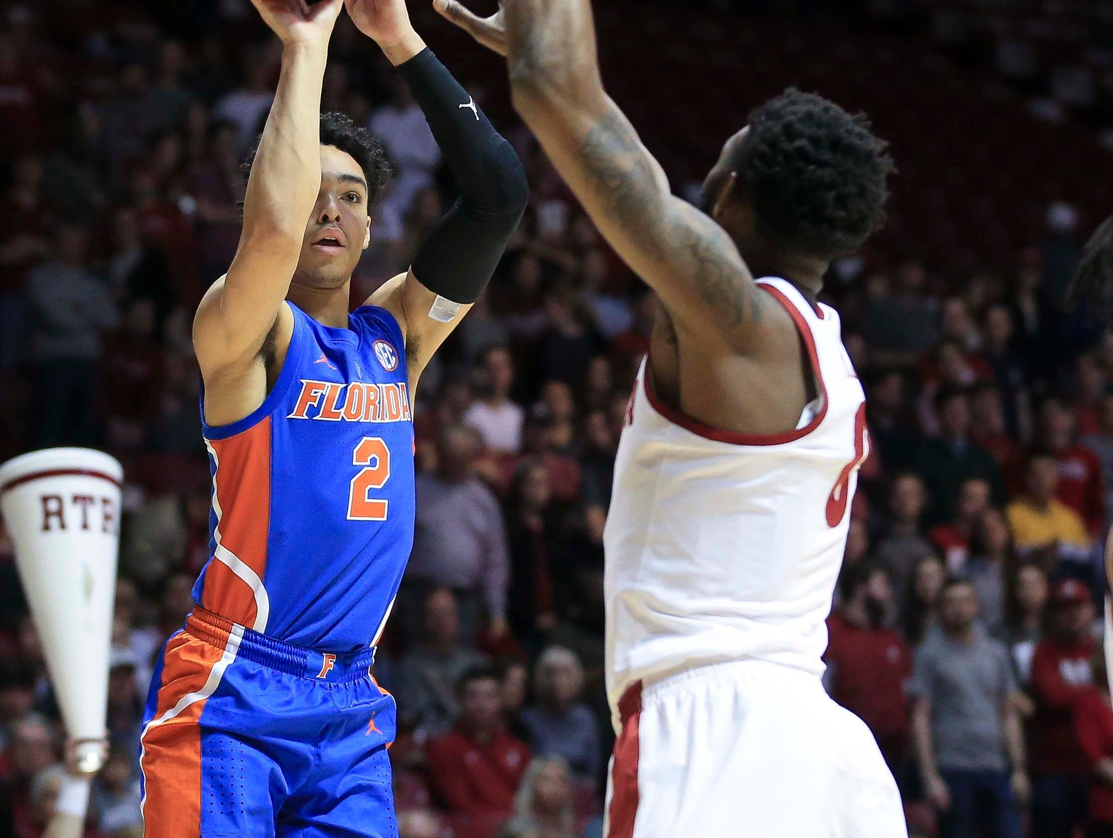 Feb 16, 2019; Tuscaloosa, AL, USA; Florida Gators guard Andrew Nembhard (2) shoots against Alabama Crimson Tide forward Donta Hall (0) during the first half at Coleman Coliseum. Mandatory Credit: Marvin Gentry-USA TODAY Sports