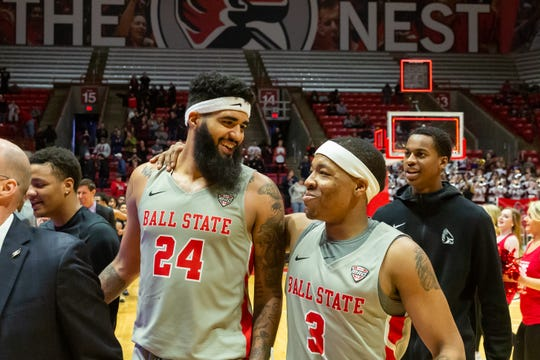 Trey Moses walks off the court with Josh Thompson after Ball State's 57-56 win over Akron on Saturday, Feb. 16, 2019 at Worthen Arena.