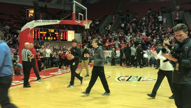 Ball State student Noah Waechter made a half-court shot to win $10,000 during Ball State's men's basketball game against Akron on Feb. 16, 2019.