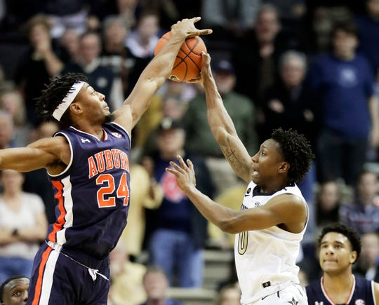 Auburn forward Anfernee McLemore (24) gets his hand on a pass by Vanderbilt guard Saben Lee (0) on Feb. 16, 2019.