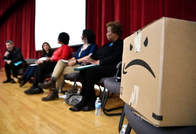 An altered Amazon box sits on the panel to represent the company that declined to send a representative to the Stand Up Nashville event: Tipping Point: Amazon and the Future of Nashville Friday at East Nashville Magnet School Friday, Feb. 15, 2019, in Nashville, Tenn.