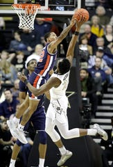 Auburn guard J'Von McCormick (12) blocks a shot by Vanderbilt forward Aaron Nesmith (24) on Feb. 16, 2019.