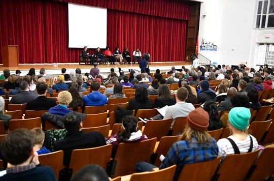 "The crowd listens to a panel discussion at the ""Tipping Point: Amazon and the Future of Nashville"" event at East Nashville Magnet School on Friday."