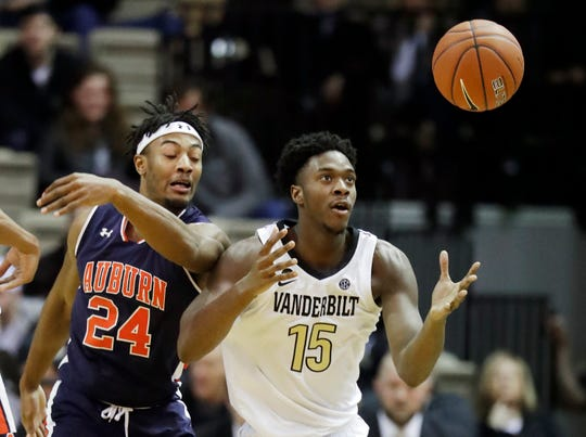 Auburn forward Anfernee McLemore (24) and Vanderbilt forward Clevon Brown (15) battle for a loose ball in the second half of an NCAA college basketball game Saturday, Feb. 16, 2019, in Nashville, Tenn.