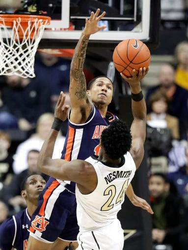Auburn Tigers guard J'Von McCormick blocks a shot by Vanderbilt forward Aaron Nesmith (24) in the first half of an NCAA college basketball game Saturday, Feb. 16, 2019, in Nashville, Tenn.