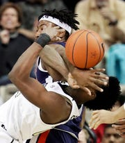 Auburn Tigers forward Anfernee McLemore, top, battles Vanderbilt forward Aaron Nesmith on Feb. 16, 2019.
