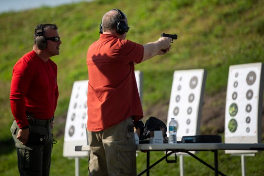 Corporal Rob Leocadio instructs Mark Soliwoda as he shoots a target at the Collier County Sheriff's Office's gun range in Naples, on Saturday, February 16, 2019.