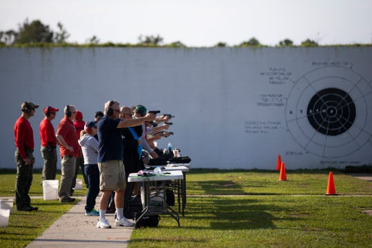 Members of the public practice shooting targets while range instructors supervise them at the Collier County Sheriff's Office's gun range in Golden Gate Estates, on Saturday, Feb. 16, 2019.