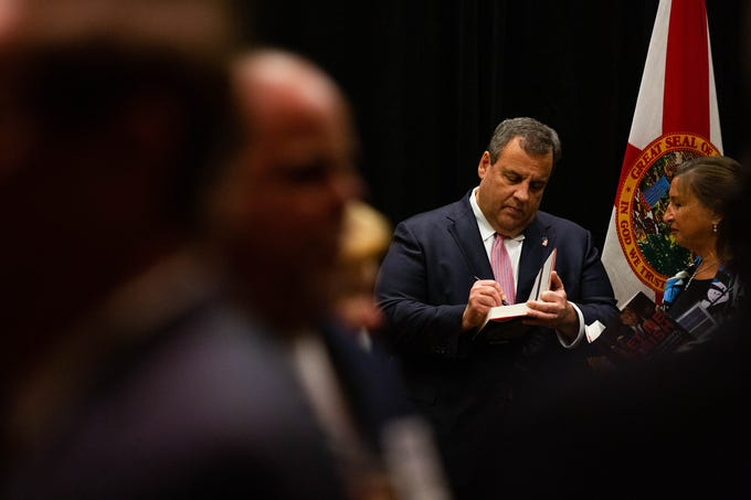 Former governor Chris Christie signs copies of his book during VIP hour at the annual Collier County Lincoln Reagan Celebration at the Hilton Naples on February 15, 2019. Christie was the keynote speaker.