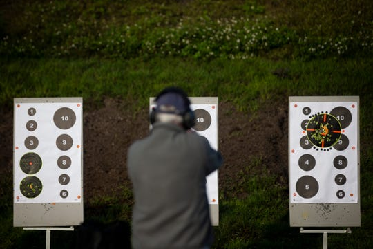Tom Mulligan shoots a target at the Collier County Sheriff's Office's gun range in Naples, on Saturday, February 16, 2019. The range is open to the public every first and third Saturday, excluding holidays, from 8 a.m. to noon.