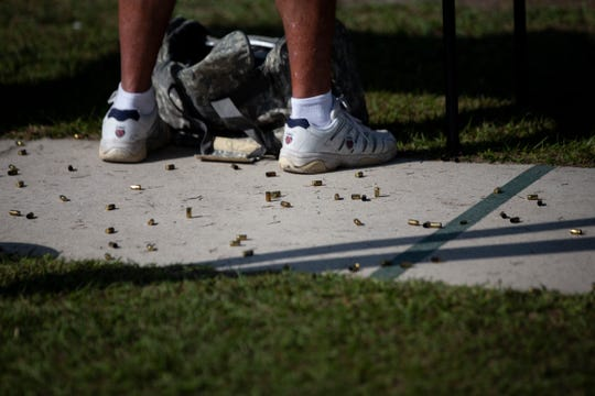 Shell casings lie scattered around Barry Garabedian's feet at the Collier County Sheriff's Office's gun range in Golden Gate Estates, on Saturday, Feb. 16, 2019. Garabedian, who lives in Naples during the winter, says he tries to come to the range as often as he can because, he says, the facilities are excellent and the instructors are very helpful.