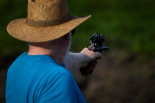 Thomas Ward shoots a target at the Collier County Sheriff's Office's gun range in Naples, on Saturday, February 16, 2019.