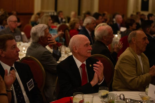 Attendees at the annual Collier County Lincoln Reagan Celebration watch as former governor Chris Christie delivers his speech at the Hilton Naples on February 15, 2019.
