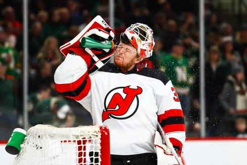 Feb 15, 2019; Saint Paul, MN, USA; New Jersey Devils goaltender Cory Schneider (35) sprays himself with water after replacing teammate Keith Kinkaid (not pictured) in the second period against the Minnesota Wild at Xcel Energy Center.