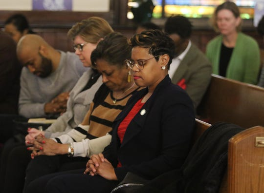 Senator Nellie Pou, Senator Sandra Cunningham and Assemblywoman Shavonda Sumter during the benediction to open the meeting on February 16, 2019. The New Jersey Institute for Social Justice and other social justice advocacy groups came together at the First Bethel AME Church to conduct the 94 Percent follow up meeting. Governor Phil Murphy received 94% of the African American vote and the meeting discusses legislation that would help the African American community.