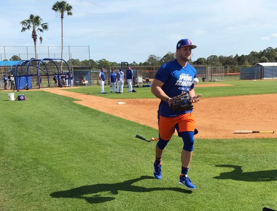 New York Mets' Tim Tebow jogs up the first baseline at spring training baseball practice Saturday, Feb. 16, 2019, in Port St. Lucie, Fla.