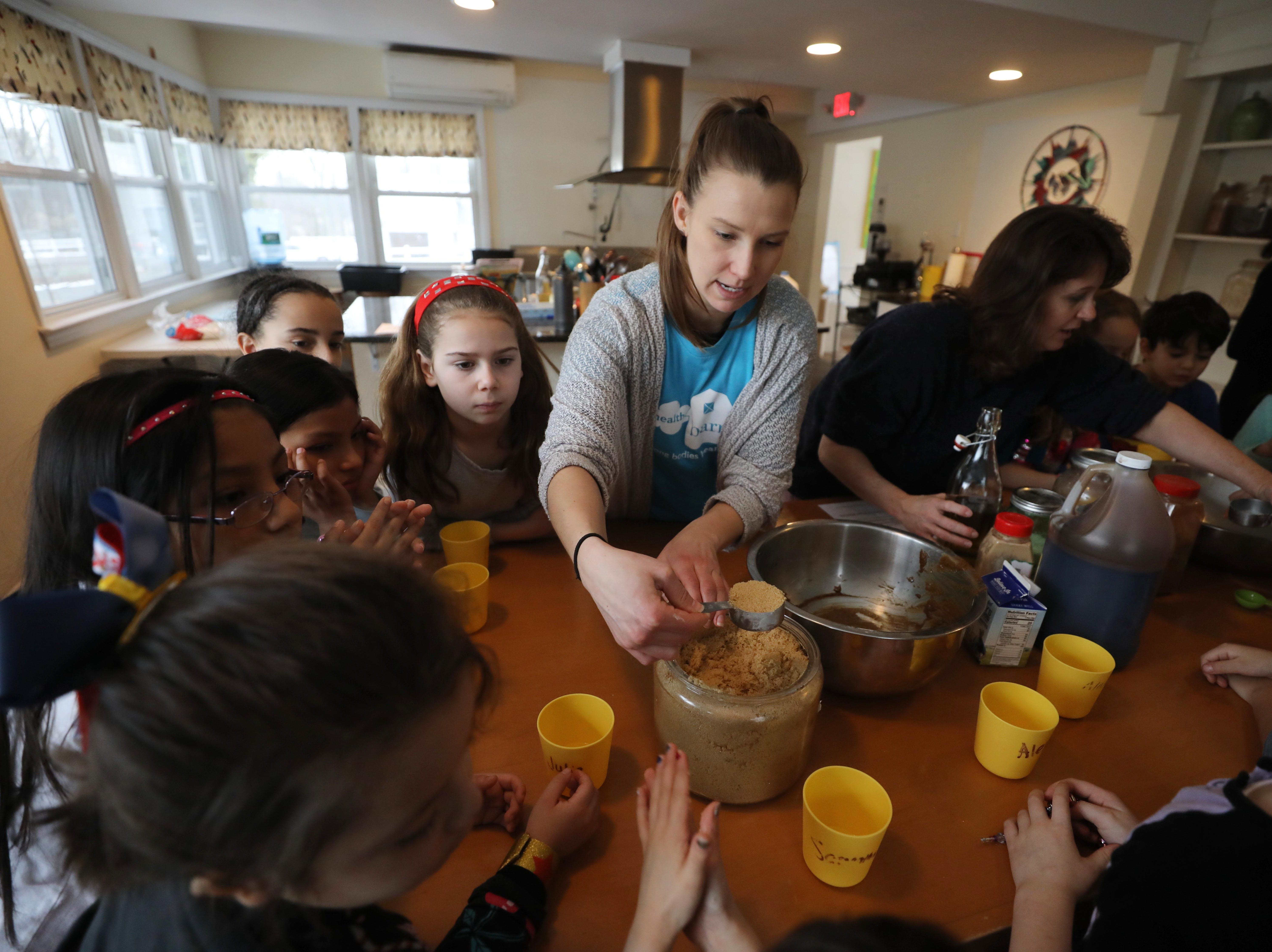 "Michelle Esten a HealthBarn USA educator mixes ingredients for ginger snap cookies that the kids attending help to make on February 15, 2019. Ridgewood Parks and Recreation, in partnership with HealthBarn USA, celebrated ""Winterfest"", a day for kids baking cookies, doing yoga and taking a nature walk."