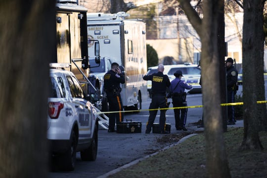 Members of the Bergen County Sheriff arrive at the scene of a double homicide in Englewood on Saturday February 16, 2019.
