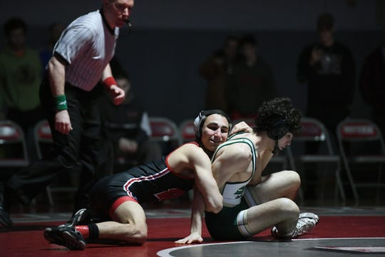 District 1 wrestling tournament at Fair Lawn High School on Saturday, February 16, 2019. (left) Trent Furman, of Westwood, on his way to defeating Michael Cetta, of Saint Joseph, in their 132 pound match.