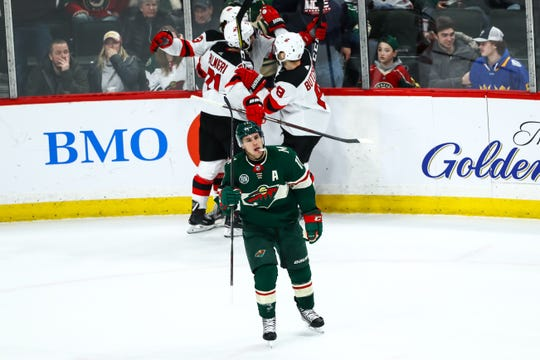 Feb 15, 2019; Saint Paul, MN, USA; Minnesota Wild left wing Zach Parise (11) reacts after New Jersey Devils center Nico Hischier (13) scores the game winning goal in overtime at Xcel Energy Center. The Devils defeated the Wild 5-4 in overtime.
