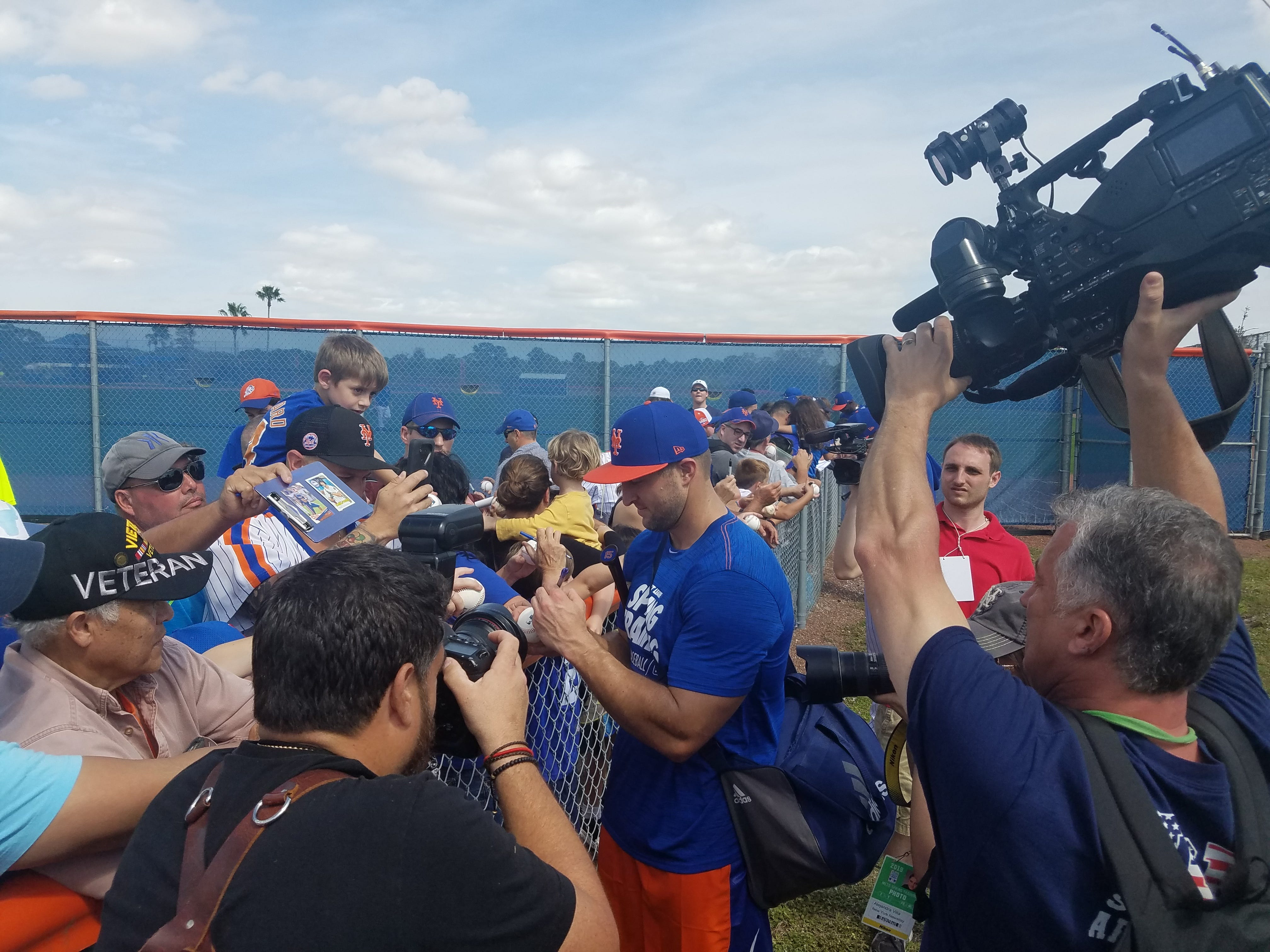 Tim Tebow signs for fans Saturday.