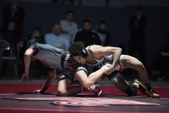 District 1 wrestling tournament at Fair Lawn High School on Saturday, February 16, 2019. (right) Sammy Alvarez, of Saint Joseph, on his way to defeating Anthony Motta, of Fair Lawn, in their 126 pound match.