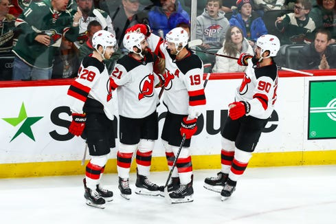 Feb 15, 2019; Saint Paul, MN, USA; New Jersey Devils right wing Kyle Palmieri (21) celebrates with teammates after scoring a goal on a powerplay in the third period against the Minnesota Wild at Xcel Energy Center. The Devils defeated the Wild 5-4 in overtime.