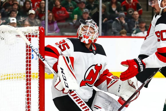 Feb 15, 2019; Saint Paul, MN, USA; New Jersey Devils goaltender Cory Schneider (35) looks at the puck in the second period against the Minnesota Wild at Xcel Energy Center.