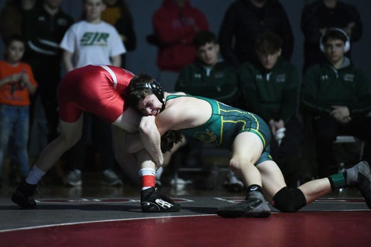 District 1 wrestling tournament at Fair Lawn High School on Saturday, February 16, 2019. (right) Justin Bierdumpfel, of Saint Joseph, on his way to defeating Devin Flannery, of High Point, in their 120 pound match.